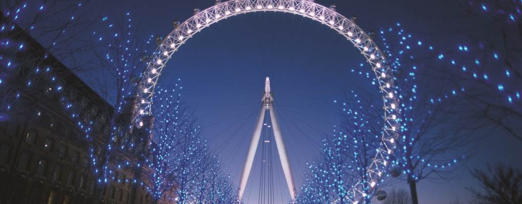 London Eye at night lit up white
