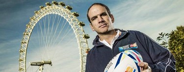 Martin Johnson holding rugby ball in front of London Eye