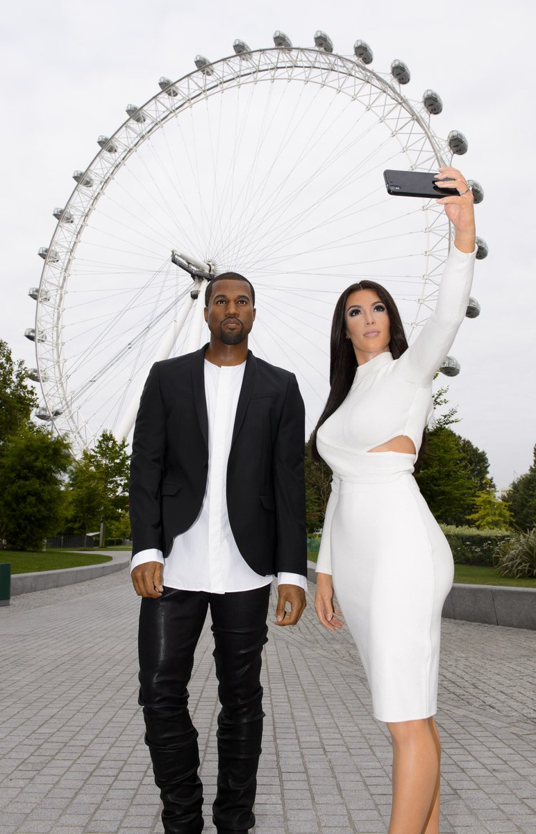 Kim Kardashian and Kanye West wax figure in front of London Eye
