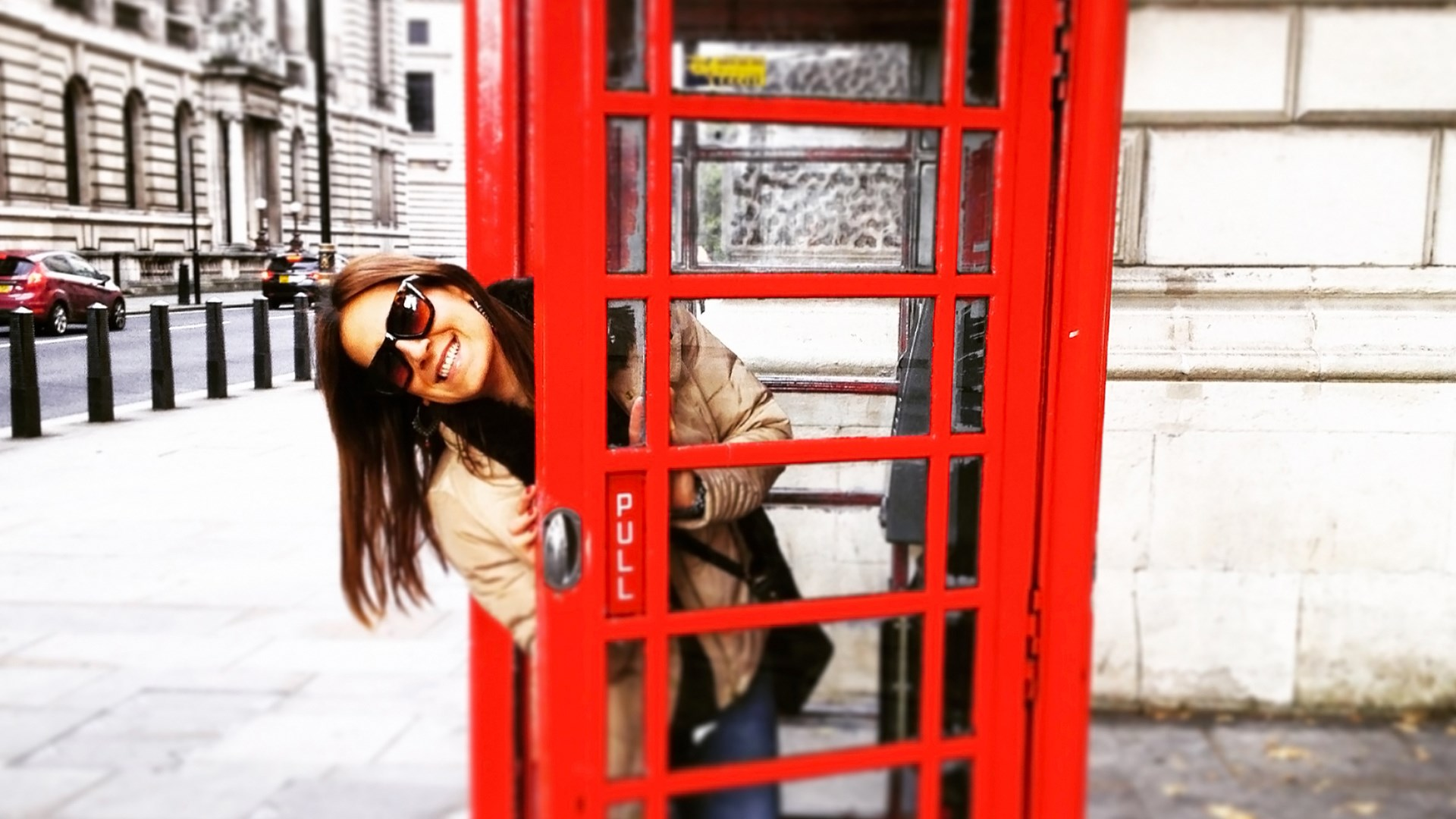 Lady in a London phone booth