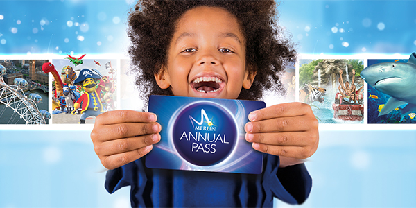 Boy holding MAP pass