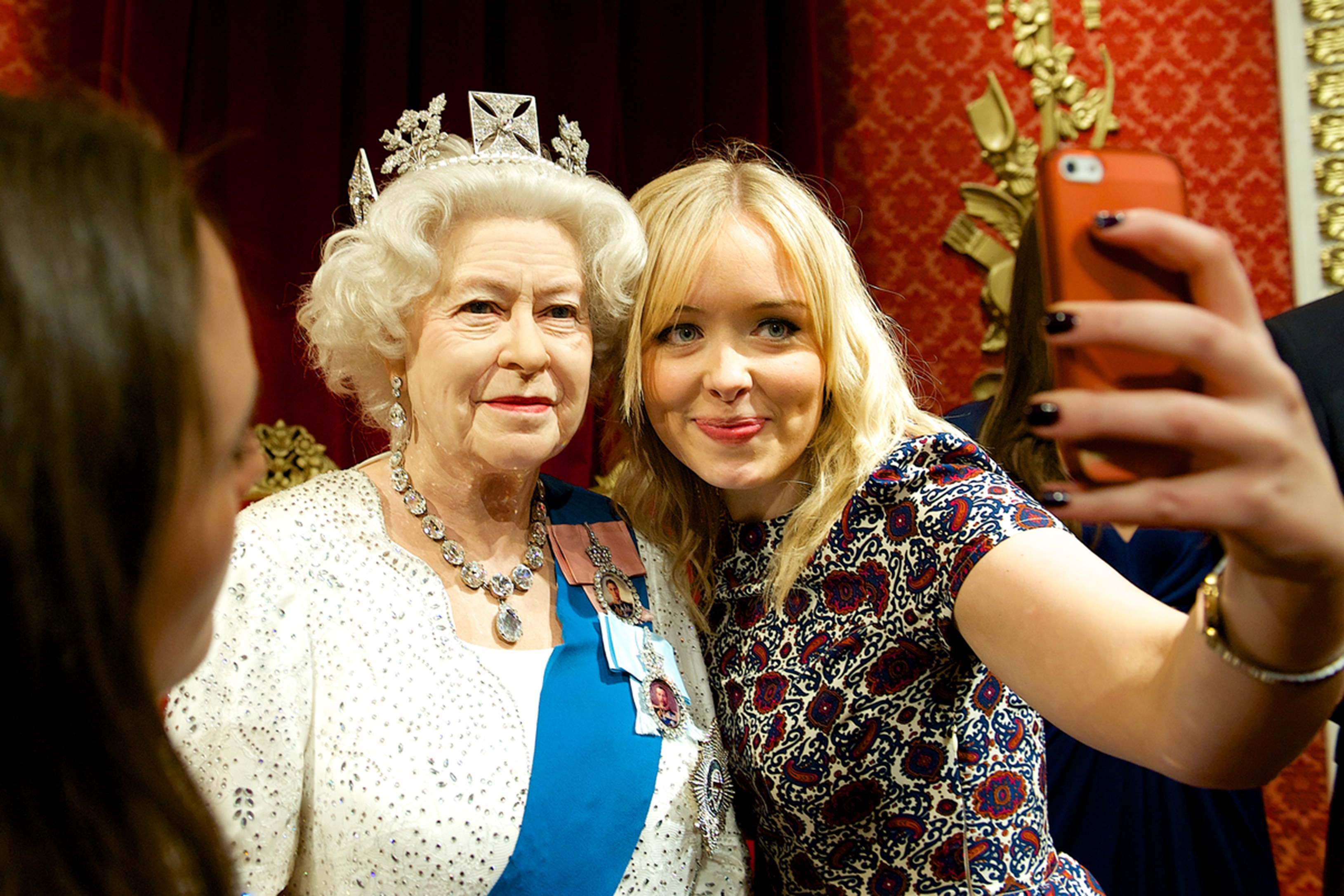 Woman taking selfie with the Queen