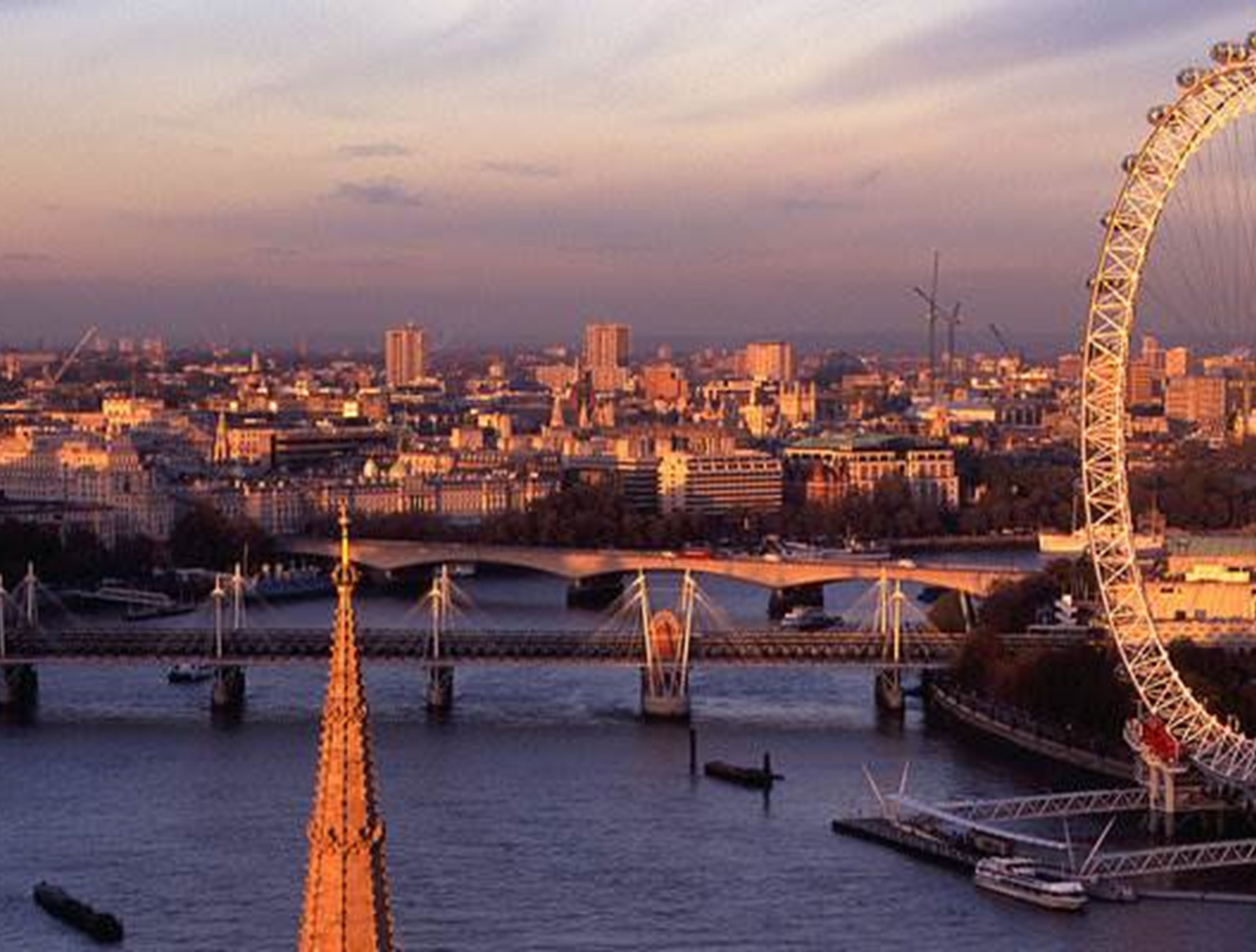 London Eye and skyline at sunset